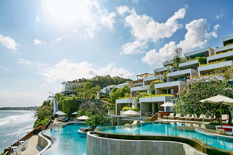 View of Anantara Uluwatu villas and pool a Bali surf resort in Indonesia