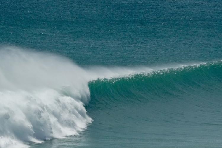 surfing at Suarga Padang Padang
