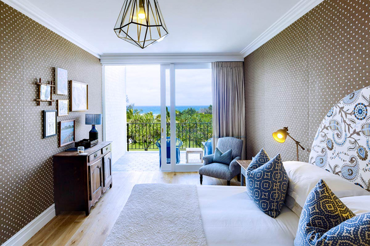 Interior of ocean superior guest room at Halcyon House