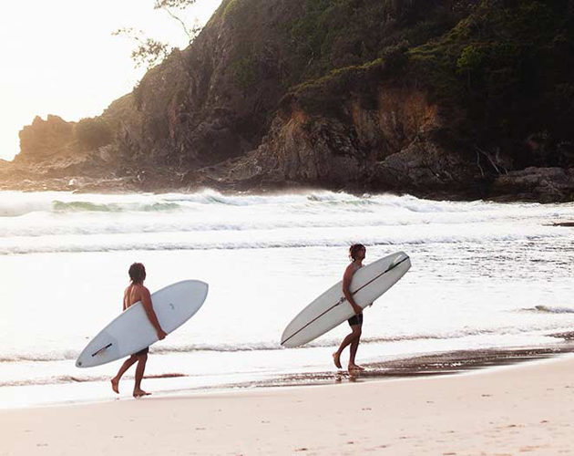 Surfers at Cabarita Beach infront of Halcyon House Australian Surf Resort