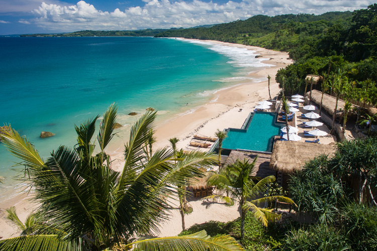 The beachfront Nio beach club and pool at Nihi Sumba the perfect destination for a family surf trip