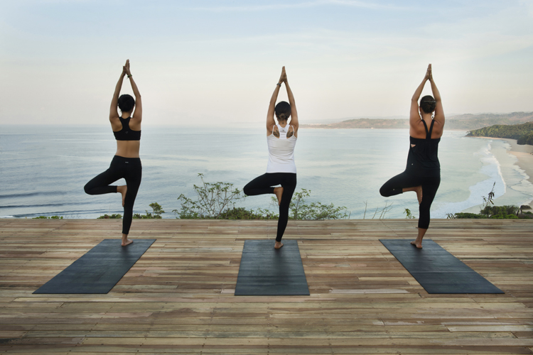 ladies doing yoga at Nihi Sumba on family surf trip