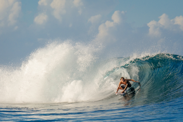 guy surfing Occy's left Nihi Sumba on family surf trip