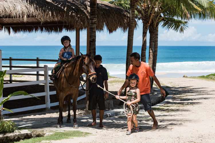 kids riding ponies at Nihi Sumba on family surf trip